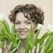 Woman with tenderness holds a bouquet of tulips — Stock Photo #13202450
