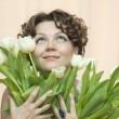 Womwith tenderness holds bouquet of tulips — Stock Photo #13202512