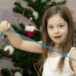 Child with decorates a fur-tree - Stock Photo