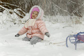 Snow falls on the girl — Stock Photo