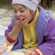 Hungry girl eats with hands — Stock Photo #40913445