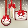 Sale labels with red gift bows — Vector de stock #34027549