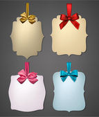 Paper gift cards with color satin bows. — Vector de stock