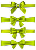 Satin green ribbons. Gift bows. — Stock Vector