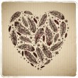 Ethnic feather heart on cardboard background — Stok Vektör #16759717
