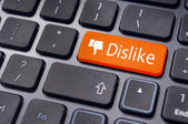 Dislike message on keyboard button, antisocial media concepts — Stock Photo