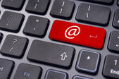 At sign on keyboard enter key, for email concepts. — Stock Photo