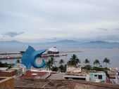 Manzanillo Harbor, Townscape, and Large blue Sail Fish Sculpture — Stock Photo