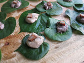 Poi on Taro Leafs top with a slice of Marin — Stock Photo