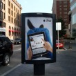 IPad Ad featuring Facebook use on an outdoor Ad stand - Stock Photo