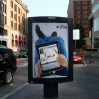 Stock Photo: IPad Ad featuring Facebook use on outdoor Ad stand