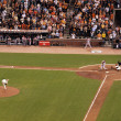 Giants Brian Wilson throws pitch as Diamondback player swings at - Stock Photo