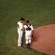 Giants Madison Bumgarner talks on the mound to Catcher Buster Po — Stock Photo #21849051