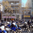 Постер, плакат: Police officers and motorcycle hang out on a closed market stree