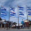 Pier 39 Flags wave in the wind as check out 3DS booths — Stock Photo