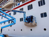 Carnival cruise inspected by workers — Stock Photo