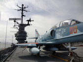 Blue Navy Plane on the deck of the USS Hornet — Stock Photo