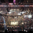 Постер, плакат: Ref holds belt up in middle of Ring before Elimination Chamber M