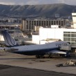 Stock Photo: United Airlines large plane rest at gate at SFO as it prepares f