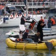 Stock Photo: Raft with person in bear suit paddles through McCovey Cove