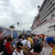 Stock Photo: Lining up to take Cruiseship tour