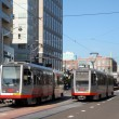 Muni Light-rail trains pass each other going in opposite directi — Stock Photo