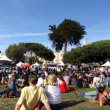 Sitting around watching the North Beach Festival Concert — Stock Photo