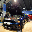 ������, ������: Shelby Ford Mustang with racing stripe displayed with hood open