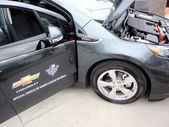 Close-up of front of Chevy Volt on display at ballpark with hood — Stock Photo
