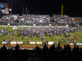 UNR Fan Cheer as players and fans celebrate on the field after e — Stock Photo
