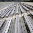 Stock Photo: Old wooden bench bleachers