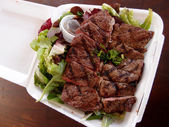 Steak with Salad on a to go Styrofoam plate — Stock Photo