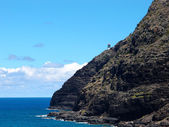 Makapu'u Lighthouse on cliffside mountain top with stretching bl — ストック写真