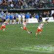 Illinois Kicker kicks football at kickoff — Stok fotoğraf