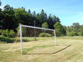 Soccer Goal with net in grassy field — Stock Photo
