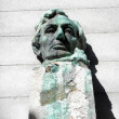 Stock Photo: Face Statue of President Abe Lincoln sitting on pedestal