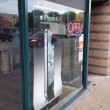 Stock Photo: Iphone 4 cellphone ad in large window of store