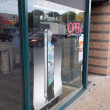 Iphone 4 cellphone ad in large window of store — Stock Photo