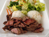 Steak, White Rice, toss salad in a styrofoam plate — Stock Photo