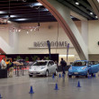 Постер, плакат: Nissan Leaf Cars parked at the electric car Nissan Leaf test dri