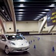 Постер, плакат: Cars in motion at the Nissan Leaf test driving area