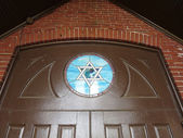 Doorway with stain glass Jewish Star — Stock Photo