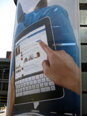 IPad Ad featuring Facebook use on an outdoor Ad at Fashion Show  — Stock Photo
