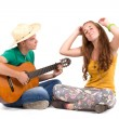 Young couple with guitar — Stock Photo