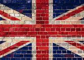 Flaga wielkiej brytanii na tle ściany cegła — Zdjęcie stockowe