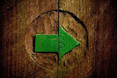 Green carved wooden arrow — Stock Photo