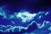Blauwe wolken en maan achtergrond — Stockfoto