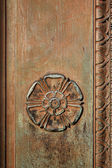 Carved Tudor Rose on a vintage doorway — Stock Photo