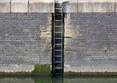 Marina quay wall and ladder — Stock Photo