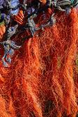 Orange fishing net drying in the sun — Stock Photo